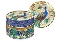 Inspired by the majestic peacock, these sets of coasters make a chic statement on a tabletop. Packaged in a beautifully designed container, they also make a lovely gift.