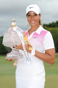 cheyenne woods pictures | Cheyenne Woods Cheyenne Woods of the United States holds the winner's trophy in Australia.
