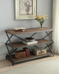"""Fabio collection oak finish wood top and antique black metal frame sofa table. Sofa table measures 48"""" x 18"""" x 30"""" H. Some assembly required."""