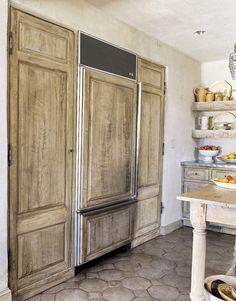 wood-paneled refrigerator.