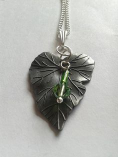 Autumn Leaf Pendant Necklace with Swarowski Crystal Peridot green bead.  https://www.etsy.com/listing/163376639/swarovski-crystal-elements-xillion