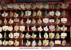 Tokyo, Japan - October, 10 2016 : The Traditional wooden wishing plaques called, Ema Many ema at Tsurugaoka