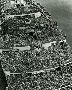 """The liner """"Queen Elizabeth"""" bringing American troops into NY Harbor at the end of WWII 1945."""