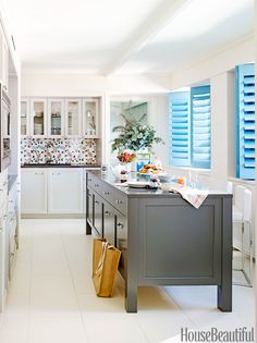 In this bright kitchen in New York City designed by Incorporated Architecture & Design, contemporary materials evoke the spirit of 19th-century England.  Annie Schlechter  - HouseBeautiful.com