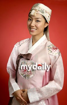 There's a variety of different headwear that can accompany a hanbok, and the design of the dress itself can be embellished with embroidered panels, or given a variation on the front panel for a more formal look like the one Seo Ji Hye wears