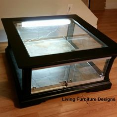 Refinishing a coffee table to hold a snake or reptile. This looks like a lot of work, but totally worth having such a nice piece of furniture enclosure.