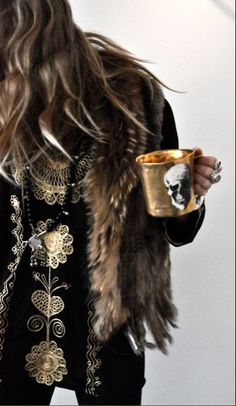 Winter boho: black blouse with gold embroideries + fur vest