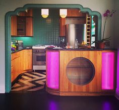 80sdeco: 80s deco wooden bar with hot pink curved lights...
