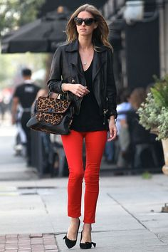 Red Jeans or cropped pants, black blouse, black leather jacket, finish with heel and handbag.