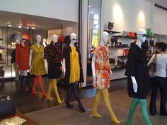 A row of runway-ready mannequins at Kate Spade Soho.     great info image