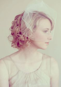 Short curly wedding hair with veil
