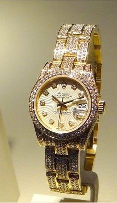 Rolex Datejust Special Edition with 18k yellow gold PearlMaster bracelet, pave diamonds and sunburst diamond dial.