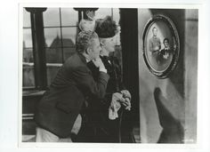 This is an original, vintage photo of Jeanette MacDonald and Nelson Eddy from Bitter Sweet. Don't know if it is a deleted scene or a candid but either way, what a tender intimate shot with Nelson hugging her shoulder and parking his chin on it. Awwww! Sweet! - ESCANO COLLECTION