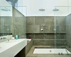 spacious-modern-bathroom-design-with-sophisticated-glass-door-plus-lovely-classic-stone-accents.jpg 1,196×960 pixels