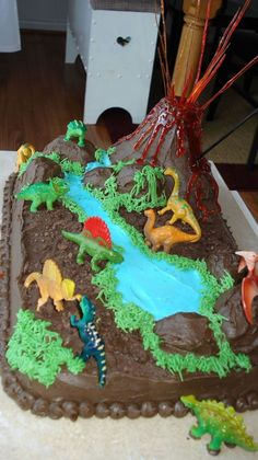 Dino Land Cake I made this one for my sons B-day this year. The cake is chocolate frosted w/ BC and I made a lollipop solution for the. 3 Year Old Birthday Cake, Dinosaur Birthday Cakes, Dinosaur Cake, Dinosaur Party, 4th Birthday, Birthday Party Themes, Volcano Cake, Lincoln Birthday, Dino Cake