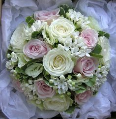 Bouquet in pale green, pink and white using Avalanche and Sweet Avalanche roses, pale green lisianthus and bouvardia with variegated pittosporum. A beautifully classic look that manages to be very soft and romantic and yet elegant too.