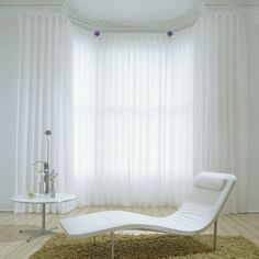"""White room."" Interior. Sheer white curtains."