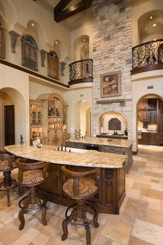 Beautiful Tuscan kitchen.  Notice the wrought iron and natural elements here.