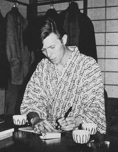 Bowie with several cups of tea