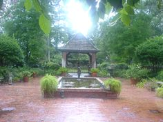 A Hays Town patio, pond, gazebo, and wall.