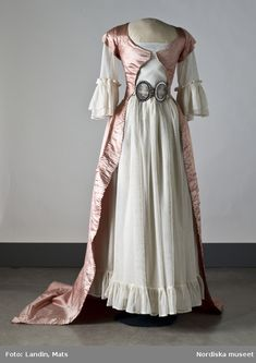 They had the common 18th century look with a flower pattern in mostly greens and pinks – not the same fabric as the dress, but they kinda matched. Description from fuchsias18thcdress.wordpress.com. I searched for this on bing.com/images