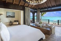 Plan a getaway at The St. Regis Mauritius Resort, a luxury hotel offering luxury accommodations, an idyllic beach, spa and more in the South West of Mauritius. Best Hotels In Mauritius, Mauritius Resorts, Mauritius Honeymoon, Mauritius Wedding, Villas, Bed Linen Inspiration, Cheap Bed Sheets, Natural Bedding, Bedding Websites