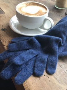 Long soft navy cashmere gloves – very cozy! Can be worn scrunched at the wrists or as an extra layer underneath your coat; they also look fabulous worn with a matching or contrasting poncho and snood. 100% Cashmere