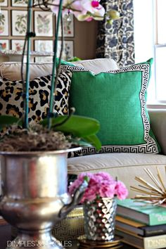 Animal print and green Greek key accent pillow.