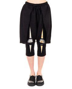 Black split leg shorts drawstring waist silk inserts two back pockets string closure 62% PL 33% RY 5% SE 54% PL 23% RY 23% AC