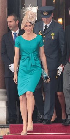 Princess Mary looks chic in the this turquoise dress and statement making headpiece.