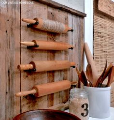 nevermind  how wonderful a collection of rolling pins is... what's that hardware holding the pins up? door stoppers! brilliant!!!