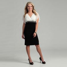 @Overstock - This lovely black and ivory dress from Scarlett features a ruched bodice with a bead embellishment. With a light stretch, this dress is finished with ruffled dolman sleeves.http://www.overstock.com/Clothing-Shoes/Scarlett-Womens-Black-Ivory-Beaded-Dress/6452561/product.html?CID=214117 $48.99