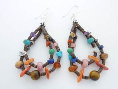 Navajo Multi Stone Sterling Silver Earrings Turquoise Tiger Eye Boyd Ashley | eBay. Navajo Native American artist, Boyd Ashley, from Northern New Mexico, hand-strung this pair of sterling silver dangle earrings with two loops of  turquoise, coral, malacite, onyx, lapis, spiny oyster beads to create a drop earring