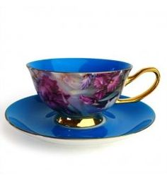 A teacup and saucer set made of genuine bone china and embellished with brilliant color.: