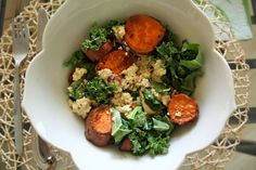 Simple salad with a tofu crumble, roasted herbed sweet potatoes on a bed of kale