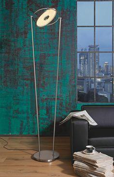 Diese Stehleuchte besticht durch ihre moderne Optik! Sie besteht aus mattem vernickeltem Edelstahl und kommt mit einem LED-Leuchtmittel zu Ihnen nach Hause. Ihr Vorteil: Sie ist schwenkbar, dimmbar und hat ein verstellbares Spotlight. Mit einer Höhe von ca. 190 cm taucht sie Ihr Wohnzimmer in ein modernes Licht. Die Stehleuchte wird Sie begeistern!