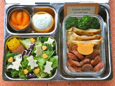 BentOnBetterLunches: mandarin oranges, a bear face hard-cooked egg , salad topped with pepper jack cheese teddy bears, with mandarin vinaigrette in a bear sauce container, and in the Satellite Dish, leftover broccoli, pierogies, & Polish sausage, topped with a cheddar bear.
