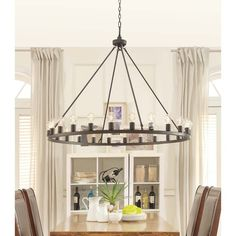 Go beyond the ordinary when you install this chandelier in your living room. This round chandelier features an oiled-bronze finish with decorative light bulbs to illuminate your room. This br Circular Chandelier, Edison Chandelier, Bronze Chandelier, Ceiling Chandelier, Wagon Wheel Chandelier, Modern Chandelier, Ceiling Lights, Chandelier In Living Room, Living Room Lighting