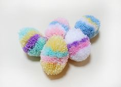 How to make the cutest and easiest Easter pom-pom eggs, via Tuts+. Pom Pom Crafts, Yarn Crafts, Diy Crafts, Making Easter Eggs, Easter Egg Crafts, Easter Garland, Easter Wreaths, Pom Pom Wreath, Yarn Projects