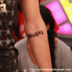 i love his believe tattoo when i get old enough to get a tattoo it will be on my lower back and say believe in cursive but with the same fading technique