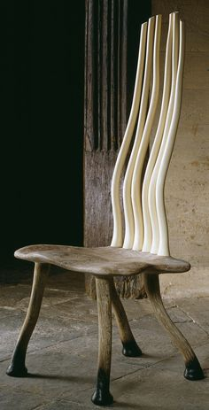 'Phoenix' chair by John Makepeace, furniture designer and maker. Holly, elm and oak.