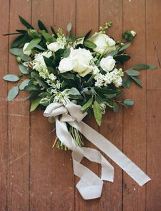 I like the proportion of standout flowers to greenery. A modest bridal bouquet.