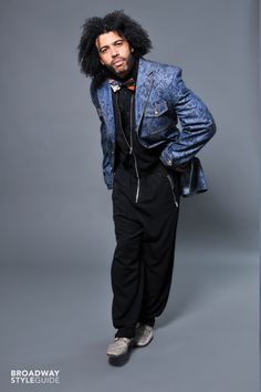 Daveed Diggs sporting a jumpsuit and blue paisley jacket