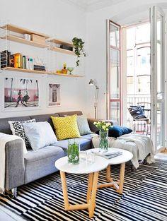 Witte muren en kleine kleuraccenten | ELLE