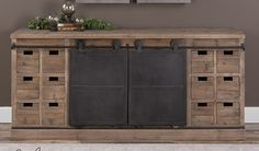 Uttermost Leandreew Media Console. Two aged-steel-finished iron doors slide on tracks over the entire piece. Uniquely rustic. $1509.