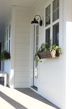 We went with an all-white exterior from Sherwin Williams called Alabaster White. The exterior is covered board and batten and horizontal 7-inch hardy plank - house tour on Home Bunch