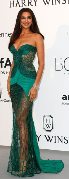 Irina Shayk wore a sheer green gown with a sweetheart neckline, which she paired with simply elegant Harry Winston jewels to the Cannes amFar gala.