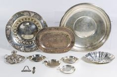 Lot 143: Sterling Silver Hollowware Assortment; Including two trays, two bowls, four ashtrays, a candle holder and a bottle marker; together with silverplated page marker