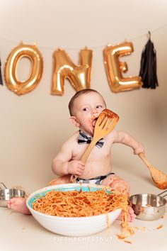 toddler licking spoon of spaghetti