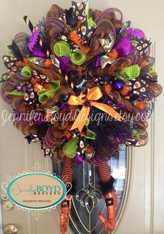 Another beautiful Halloween wreath from Jennifer Boyd Designs.  https://www.etsy.com/shop/JenniferBoydDesigns Wreath is made of orange and black deco mesh, assorted deco mesh and Halloween ribbons. RAZ witches broom and RAZ witch legs purchased at http://www.trendytree.com.